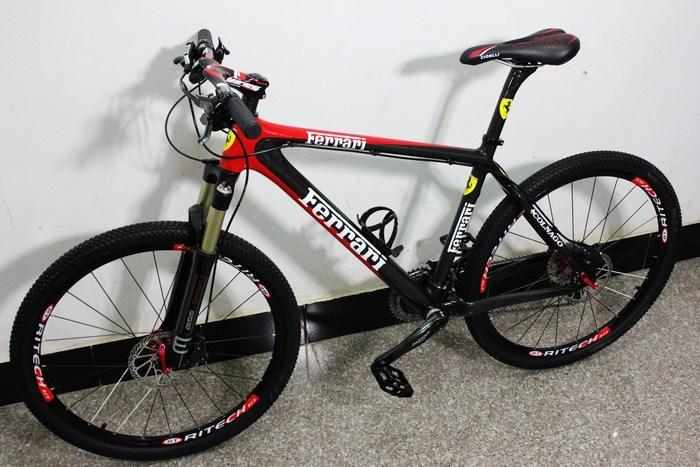 法拉利山地自行车 全碳纤维车架 shimano 30速.油碟高清图片