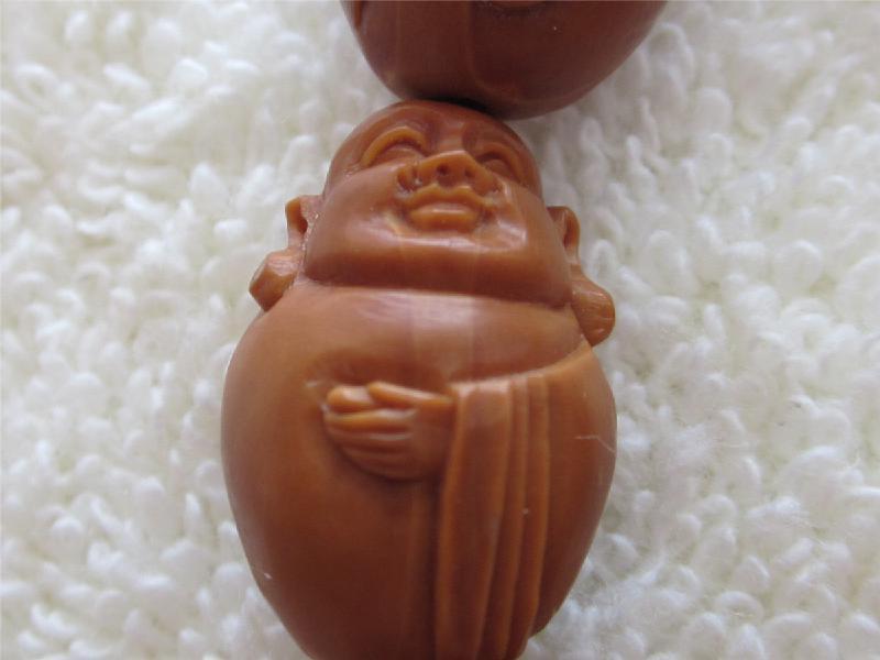 橄榄核雕   橄榄核雕图片简述:手工雕刻 弥勒佛手串,尺寸有...