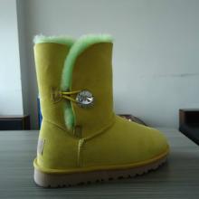 供应进口羊皮毛一体中筒儿童靴 黄板绿毛双色保暖雪地靴大量批发