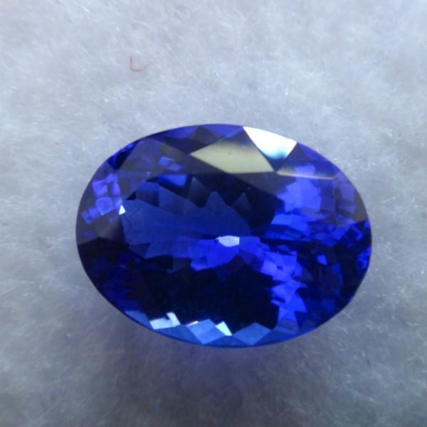 供应经典坦桑蓝宝石纯天然椭圆形坦桑石批发QQ:2501326982