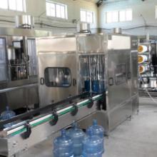 供应内蒙包头大桶灌装系统生产厂家,由廊坊兴达提供80-1200桶/小时桶装水流水线厂家报价批发